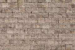 Wall of bricks. Brick is a rectangular block of clay mixed with sand and fired in a kiln or baked by the sun, used in building construction Stock Image