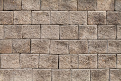 Wall of bricks. Brick is a rectangular block of clay mixed with sand and fired in a kiln or baked by the sun, used in building construction Stock Images