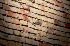 A wall of bricks in a house under construction as an abstract background stock photo