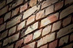A wall of bricks in a house under construction as an abstract background stock image