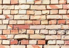A wall of bricks in a house under construction as an abstract background royalty free stock photo