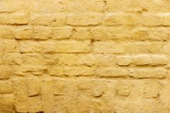 The wall of bricks painted in yellow Stock Photography