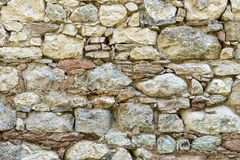 Wall with bright natural stones. Wall with big and small, bright natural stones stock photography