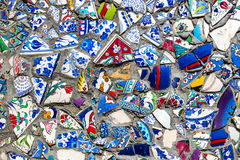 Wall with broken ceramic plates Royalty Free Stock Image