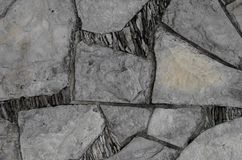 Wall with broken pieces of stones in geometric shapes. royalty free stock images