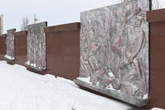 Wall with bronze bas-reliefs, depicting the tragic events of wartime at the memorial complex `Krasnaya Gorka` in the city of Evpat Royalty Free Stock Photos