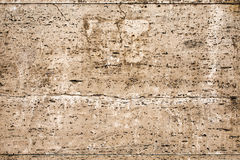 Wall with brown beige decorative cladding - travertine 1 Royalty Free Stock Photography