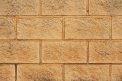 wall of brown concrete blocks royalty free stock image