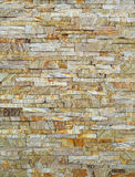 Wall of brown stone Stock Photos