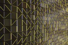 Wall of brushed metal tiles with diagonal glowing elements Royalty Free Stock Images