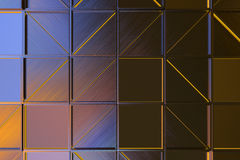 Wall of brushed metal tiles with diagonal glowing elements Royalty Free Stock Image