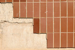 Wall of a buiding half covered with brown tiles a Stock Photography