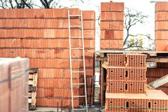 Wall building with professional bricks, construction site of new house Stock Photo