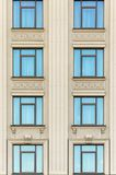 Wall of a building with windows. Wall of a building with blue windows Royalty Free Stock Images