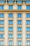 Wall of a building with windows. Wall of a building with blue windows Royalty Free Stock Photography