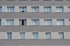 Wall of a building with windows. Stock Image
