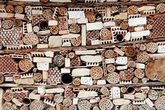 Wall Built of All Kind of Bricks, Stones and Sticks. royalty free stock photography