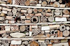 Wall Built of All Kind of Bricks, Stones and Sticks. stock photo