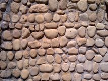 Cobblestone Wall. A wall built with cobblestone stock image