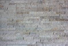 Wall built of granite blocks Stock Photo