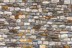 Wall built of natural stone Stock Photo
