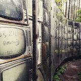 Wall built of old retro TV. The open air art object in park of Europe, Vilnius, Lithuania stock image