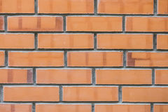 Wall built from red brick clay Stock Photos