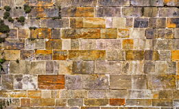 The wall built of regular stones background. Texture of old stonework. Space for text. The concept of reliability Stock Image