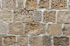 Wall built of rough weathered sandstone blocks Royalty Free Stock Photo