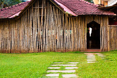 Wall of bungalow made of bamboo. Grass and path Royalty Free Stock Image