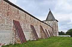 Wall with buttresses and tower of ancient monastery. Svitochnaya tower and wall with buttresses of the Kirillo-Belozersky (St. Cyril-Belozersky) monastery Stock Image