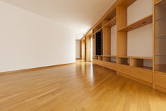 Wall cabinet in empty room Stock Photos