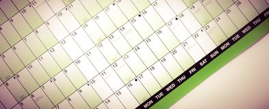 Wall calendar with days and dates isolated from blurred background. Planner stock photos