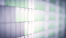 Wall calendar with days and dates isolated from blurred background. Wall planner stock photos