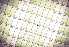 Wall calendar with days and dates isolated from blurred background. Wall planner royalty free stock photography