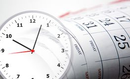 Wall calendar with the number of days and clockface. Wall calendar calendar with the number of days and clock close up Stock Images