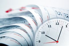 Wall calendar with the number of days and clockface. Wall calendar calendar with the number of days and clock close up Stock Photos