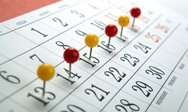 Wall calendar with number of days needles in a row. Close up stock images
