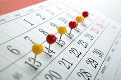 Wall calendar with number of days needles in a row. Close up royalty free stock photography
