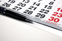Wall calendar with pen closeup Royalty Free Stock Image