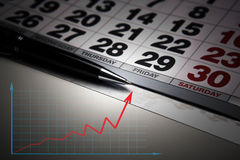 Wall calendar with pen closeup Stock Photo