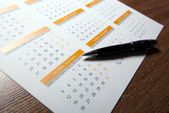 Wall calendar with pen closeup Stock Image