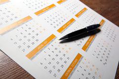 Wall calendar with pen closeup Royalty Free Stock Photo