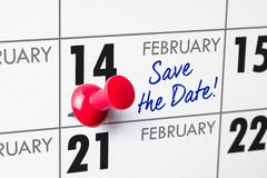 February 14. Wall calendar with a red pin - February 14 stock photography