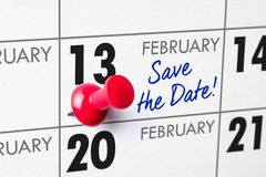February 13. Wall calendar with a red pin - February 13 stock photography