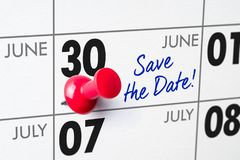 Wall calendar with a red pin - June 30 Royalty Free Stock Photography