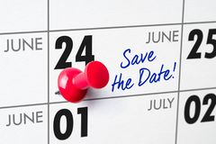 Wall calendar with a red pin - June 24 royalty free stock images