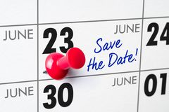 Wall calendar with a red pin - June 23 Stock Photography