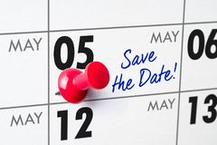 Wall calendar with a red pin - May 05 Stock Photo