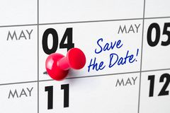 Wall calendar with a red pin - May 04 Stock Photos